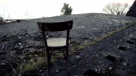 DOLLY: Old abandoned place remains with a chair video