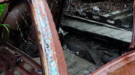 Old abandoned rusty car ruined by corrosion, panning video video