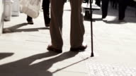 Old age pensioner walking with stick video