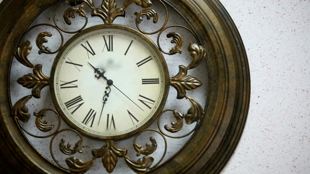 Old antique clock on the wall video
