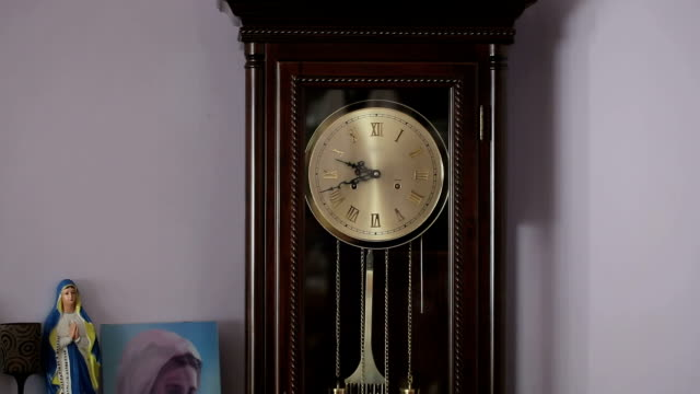 Old antique clock with statuette of the Virgin Mary video