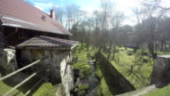 Old architecture building and brook water flow in park video
