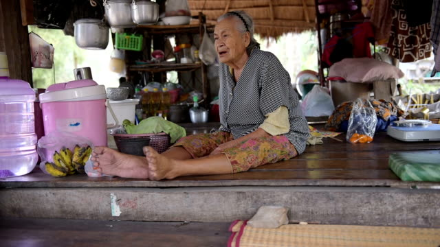 old asia woman. video