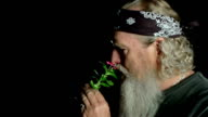 Old Biker puts a flower in his hair video