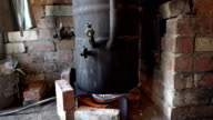 old black vat boil on the fire in rural kitchen. FullHD video