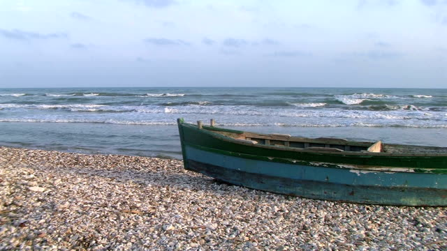 Old boat on the beach. video