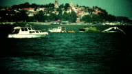 Old city and boats - retro, 1950's camera footage video