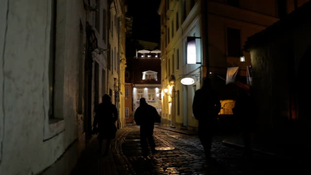 Old city at night. Silhouettes of people. video