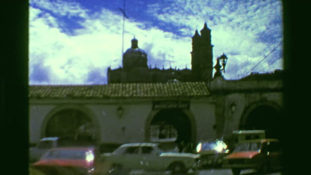 1978: Old city center diving taxi windshield view archway stone buildings. video