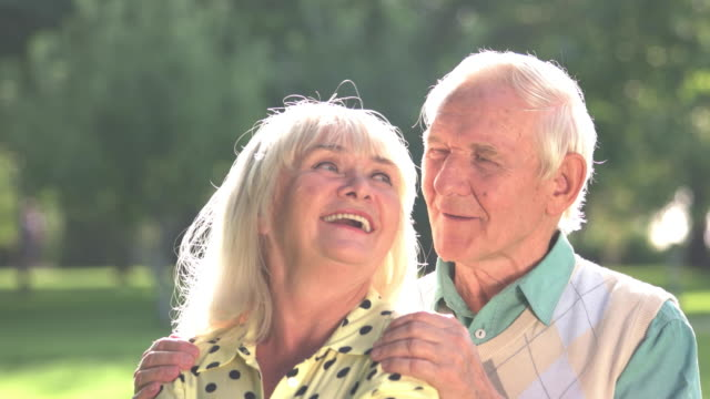Old couple outdoors. video