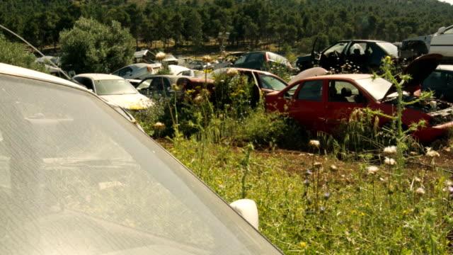 Old crushed cars at junkyard video