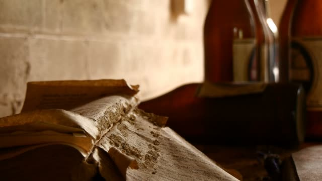 Old dusty book with torn pages flapping in wind abandoned space video