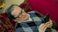 Old elder senior man on mobile smart phone video