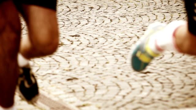 Old european city marathon. Running competitors muscled legs video video