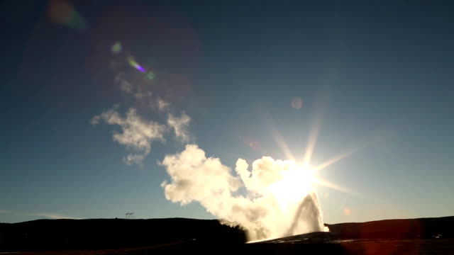 Old Faithful Erupting in front of the Setting Sun. video