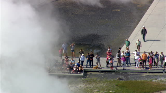 Old Faithful Erupts  - Aerial View - Wyoming,  Teton County,  helicopter filming,  aerial video,  cineflex,  establishing shot,  United States video
