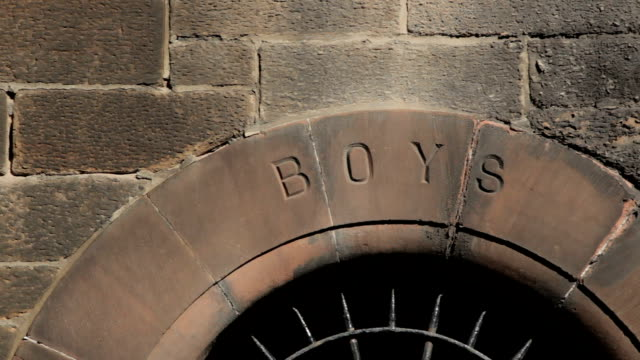 Old fashioned school entrance for boys only video