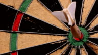 old feathered darts strike a dartboard video