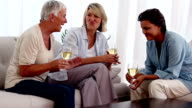Old friends catching up over glasses of wine video