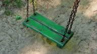 Old green empty swing. video