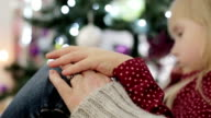 Old hand with the ring. Little blond girl put down her hand on grandmother's hand. video