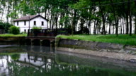 old house and dike on a river video