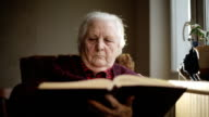 Old human reading a book. video