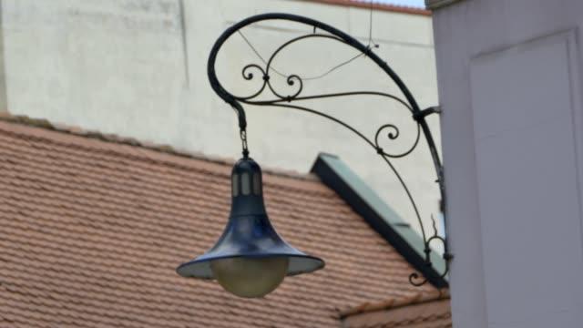 OLd Lantern Swinging in Wind video