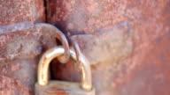 old lock on rusty gate video