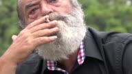 Old Man Beard Smoking Outdoors Unhealthy video
