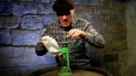 Old man cleaning oil lamp video