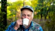 Old man drinks tea video