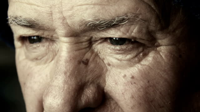 old man eyes: closeup portrait on elderly man face with blue eyes video