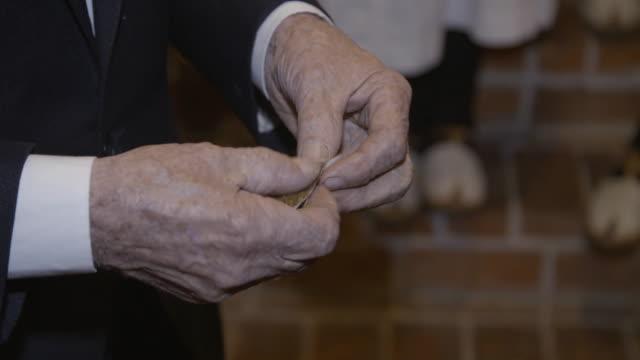 Old man prepares handmade cigar video
