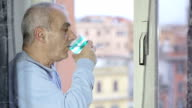 old man quenches his thirst by drinking water very quickly video