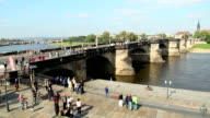 Old medieval bridge in German city, week end tourist groups. Beautiful shot of Europe, culture and landscapes. Traveling sightseeing, tourist views landmarks of Germany. World travel, west European trip cityscape, outdoor shot video