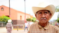 Old Mexican cowboy poses for the camera video