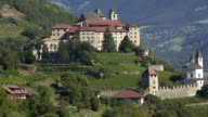 Old Monastery on Mountain Rock in South Tyrol TILT UP video