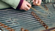 Old musical instrument. Cimbalom player play music on string instrument video