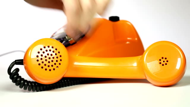 old orange telephone - dial phone number video
