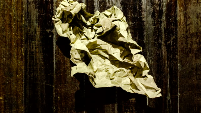 old paper ball unwrapping stop motion video