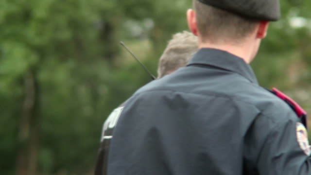 Old policeman with walky-talky dispatched on emergency call video