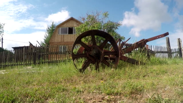 Old rusted plow on field video