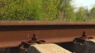 Old rustic railroad track in springtime. video