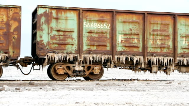 Old rusty train wagons with stalactites of salt at the lake Baskunchak video