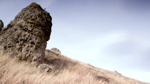 old stone in front of glying clouds video