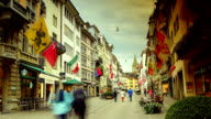 ZURICH - Old street in Zurich decorated with flags, time lapse, video