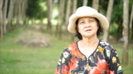 Old thai woman standing in garden video