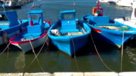 Old town fishing harbour with small boats video