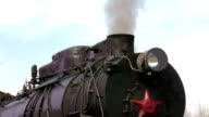 old train with steam engine closeup video